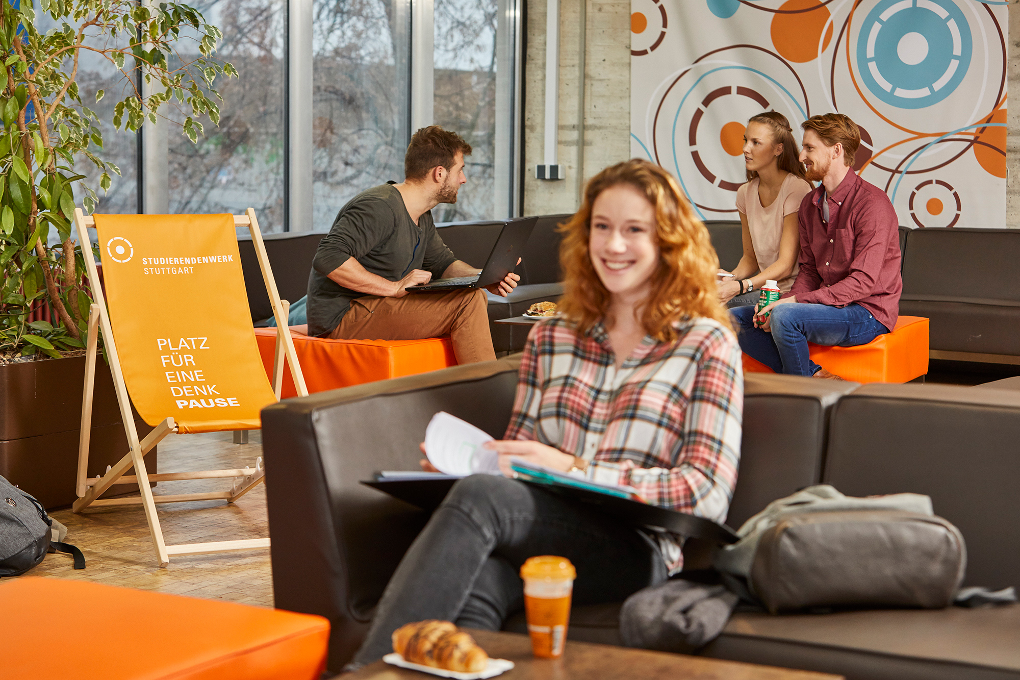 Students learning in the coffee lounge