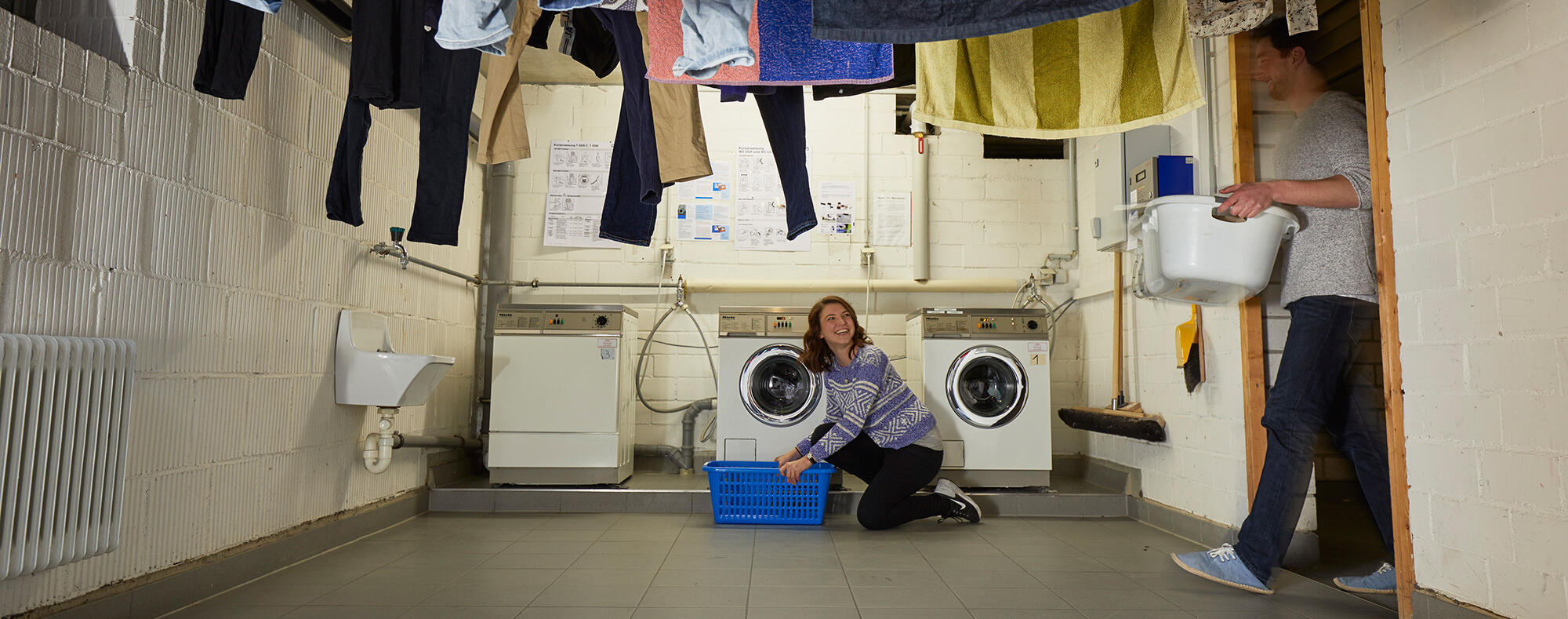Female student washing clothes